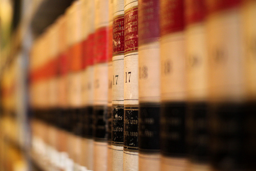 Image shows a stack of legal books to represent the sense of justice lost in this family law news story